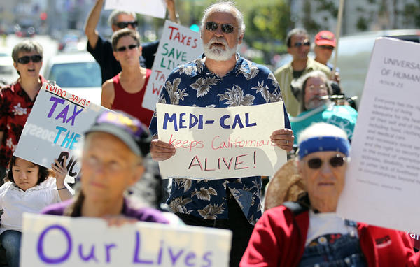 In San Francisco in September, dozens of people with disabilities gathered to protest proposed cuts to Medicaid and Medicare programs. The Supreme Court will hear the case on Monday.