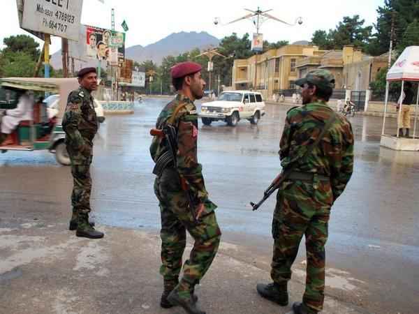 Pakistani security personnel stand alert on a street in Quetta in September. Proposed appropriations bills in both the U.S. House and Senate make economic and military assistance to Pakistan conditional.