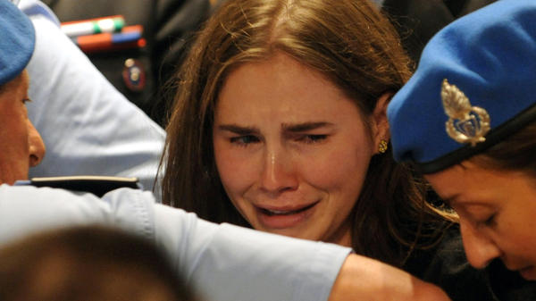 <p>Amanda Knox weeps in an Italian appeals court as her murder verdict is overturned. In 2009, Knox was found guilty of charges stemming from the stabbing death of fellow student Meredith Kercher in Perugia, Italy.</p>