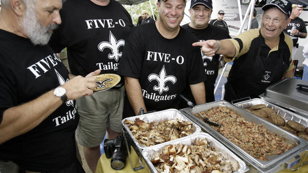 <p>Tailgaters enjoy the food before a Tennessee Titans-New Orleans Saints football game in 2007.</p>