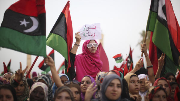 <p>In Tripoli, Libya, women celebrate the revolution against Moammar Gadhafi's regime and call for a strengthening of women's rights, Sept. 2. After playing large but largely unsung roles during the uprising, women are now seeking a greater political role.</p>