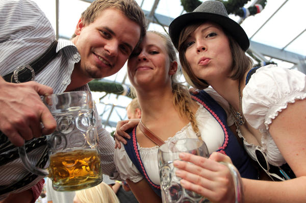 <p>Revelers clink their beer mugs inside a beer tent on the last day of Oktoberfest in Munich. The festival drew some 6.9 million visitors this year.</p>