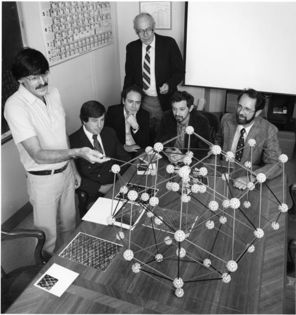 <p>Daniel Shechtman (left) discusses the quasicrystal's structure with collaborators in 1985, just months after shaking the foundations of materials science. Shechtman was awarded the 2011 Nobel Prize for chemistry.</p>