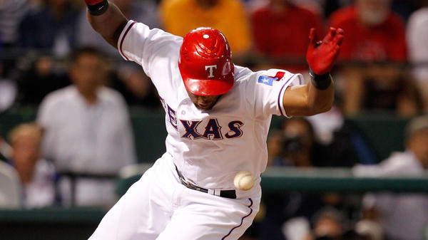 <p>Adrian Beltre of the Texas Rangers is hit by a pitch from the Tampa Bay Rays' James Shields on Oct. 1 at Rangers Ballpark in Arlington, Texas.</p>
