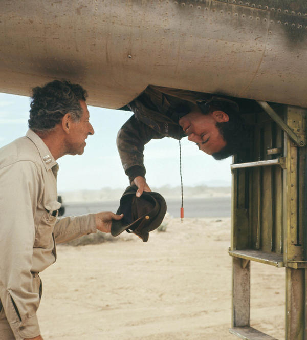 """<p><strong></strong> In the 1970 film adaptation of Joseph Heller's novel, physician """"Doc"""" Daneeka (left), played by Jack Gilford, explains the Catch-22 paradox to Capt. John Yossarian (Alan Arkin): """"Anyone who wants to get out of combat isn't really crazy,"""" Daneeka says.</p>"""