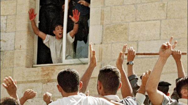 <p>Palestinian Abdel Aziz Salha shows off his bloody hands following the killing of two Israeli soldiers in the West Bank town of Ramallah in 2000. He was later arrested and is among the Palestinians set to be freed in a prisoner exchange with Israel on Tuesday. </p>
