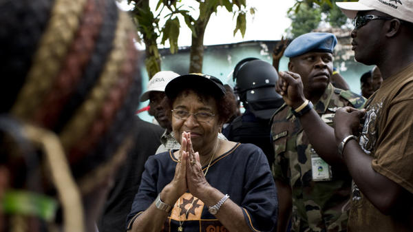 <p>Liberian President Ellen Johnson Sirleaf addresses a crowd of supporters on Saturday outside offices of her party on the outskirts of Monrovia, Liberia's capital. She faces Winston Tubman in a runoff election scheduled for Nov. 8. </p>