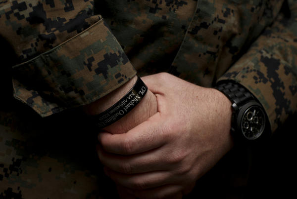 <p>Petty Officer 3rd Class Matthew Nolen, a corpsman with Company L, 3rd Battalion, 8th Marine Regiment, wears a memorial bracelet or KIA (killed in action) bracelet in honor of his fallen squad leader Cpl. Michael W. Ouellette, who was killed during a patrol in Afghanistan. </p>