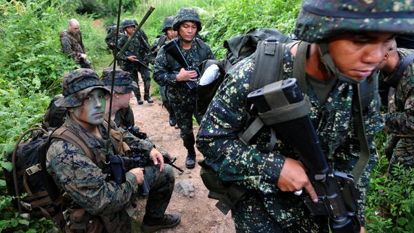 <p>U.S. Marines and their Filipino counterparts take part in a training exercise last year in the Philippines. The U.S. has a history of sending small military contingents abroad.</p>