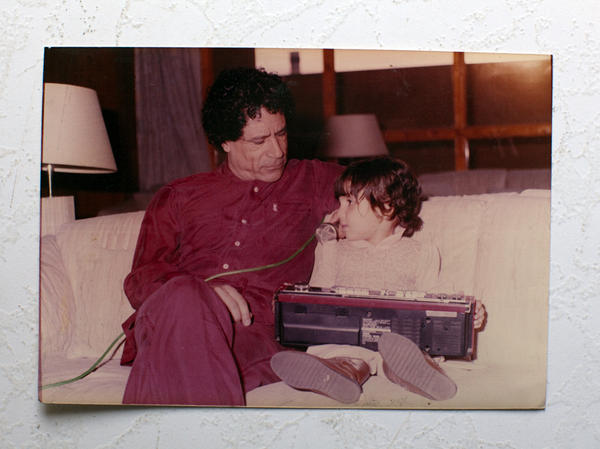 "<p>Moammar Gadhafi plays with his daughter. <em>Foreign Policy</em> has a <a href=""http://www.foreignpolicy.com/articles/2011/10/20/qaddafi_dead_photos_secret_archive_family"">Family Scrapbook</a>, with never-before-seen pictures.</p>"