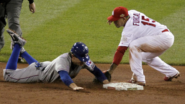 <p>The Rangers' Ian Kinsler steals second in the ninth inning, barely beating the tag by the Cardinals' Rafael Furcal. The steal sparked a game-winning rally for Texas.</p>