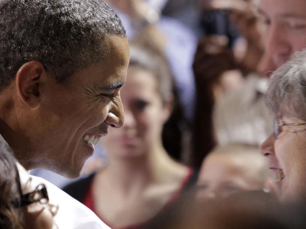 <p>President Obama greets people at Fire Station 9 in North Chesterfield, Va., on Wednesday. He was on his three-day bus tour through North Carolina and Virginia to push for his jobs bill. Next, he heads to Colorado and Nevada.</p>
