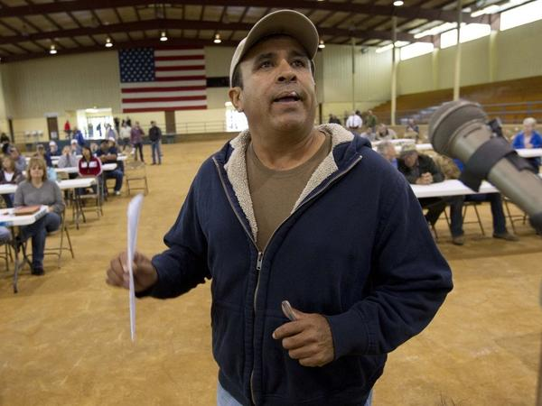 <p>Migrant worker Felipe Chacoa of Mexico talks about his desire to continue to harvest produce during a meeting of farmers and state officials to discuss the impact of the Alabama Immigration law on their livelihoods in Oneonta, Ala.</p>