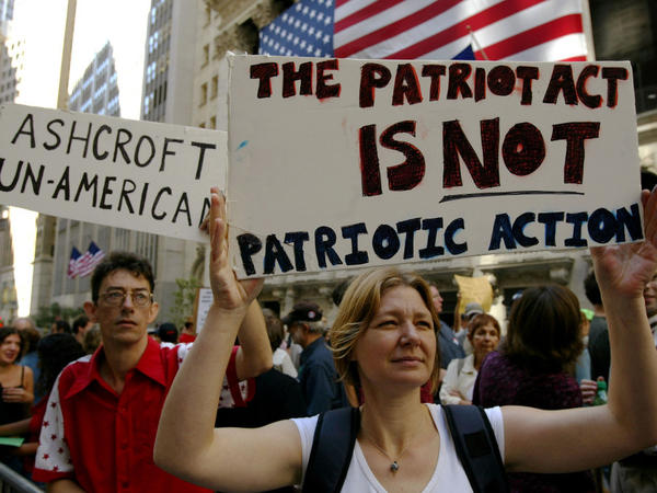 <p>Protesters hold up signs outside of Federal Hall during a demonstration against then-U.S. Attorney General John Ashcroft in 2003 in New York City. </p>