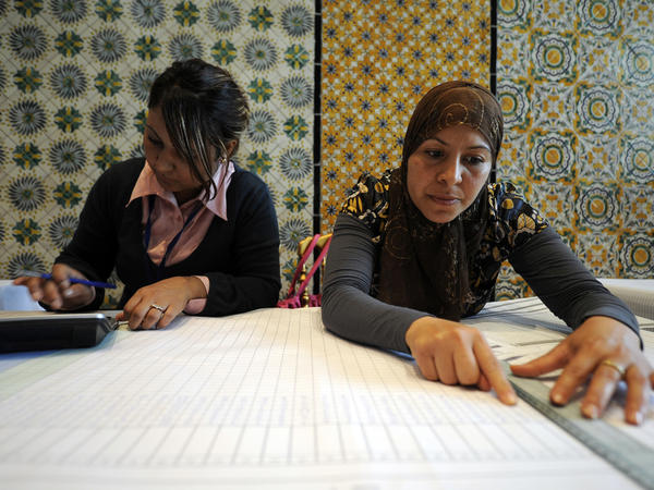 <p>On Monday in Tunis, members of a regional election authority collect voting results. Tunisians and foreign observers alike were pleased with the way the voting was carried out.</p>