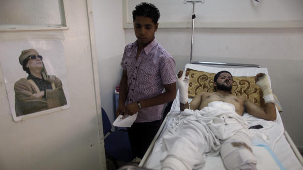<p>On an Aug. 10 tour organized by Moammar Gadhafi's governement, an unidentified man lies in a hospital bed in Tripoli. He was allegedly injured during NATO airstrikes a day earlier. </p>