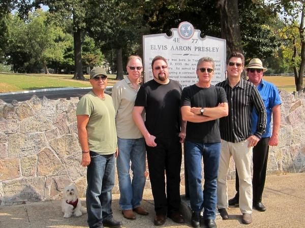 <p>Rodney the Maltese dog takes a photo with the band at Graceland.</p>