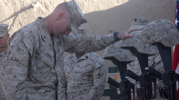 <p>Lt. Col. Jason Morris pays his respects at a memorial service in Sangin, Afghanistan, on Nov. 26, 2010, for three Marines who were killed: Lance Cpl. Brandon Pearson, Lance Cpl. Matthew Broehm and 1st Lt. Robert Kelly. Morris commanded a battalion in volatile Helmand province that suffered the highest casualty rate of any Marine unit in the Afghanistan War.</p>
