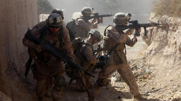 <p>U.S. Marines with 3rd Battalion, 5th Regiment and the Afghan National Army provide cover as they move out of a dangerous area after taking enemy sniper fire during a security patrol in Sangin, Afghanistan, in November 2010. During its seven-month deployment, the 3/5 sustained the highest casualty rate of any Marine unit during the Afghan war, losing 25 men.</p>