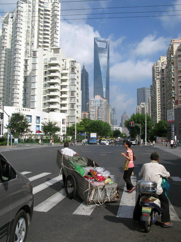 <p>Despite its ultra-modern skyscrapers and paved streets, some Shanghai residents still transport items on carts.</p>