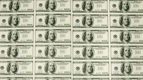 <p>Sheets of $100 bills wait to be cut into singles at the Bureau of Engraving and Printing in Washington, D.C. In recent decades, the gap between rich and poor has widened in the United States.</p>