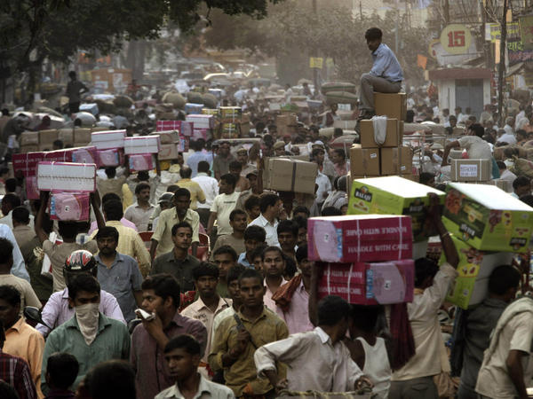 <p>Crowds pack a wholesale market in New Delhi. Already the second most populous country with 1.2 billion people, India is expected to overtake China around 2030.</p>