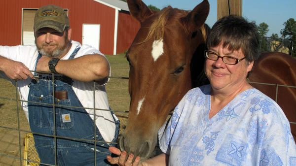 <p>Norris and Janis Galatas at their home in Collinsville, Miss., with their horse, Cinnamon. The couple is struggling to make their mortgage payments.</p>