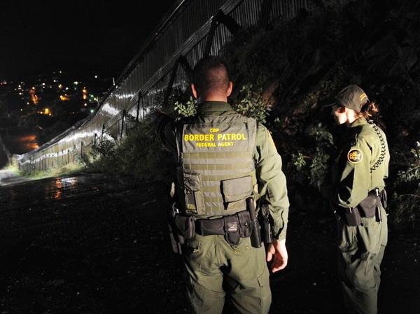 U.S. Border Patrol agents patrol along the border fence between Arizona and Mexico, July 28, 2010.