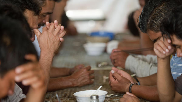 A group of illegal immigrants from Central America deported from the United States eat at a shelter near the Mexico-U.S. border, in Nogales, Sonora, Mexico, July 28, 2010. Last year, the U.S. deported a record number of immigrants — and the Mexican border towns where they are being released face serious problems coping with the influx.