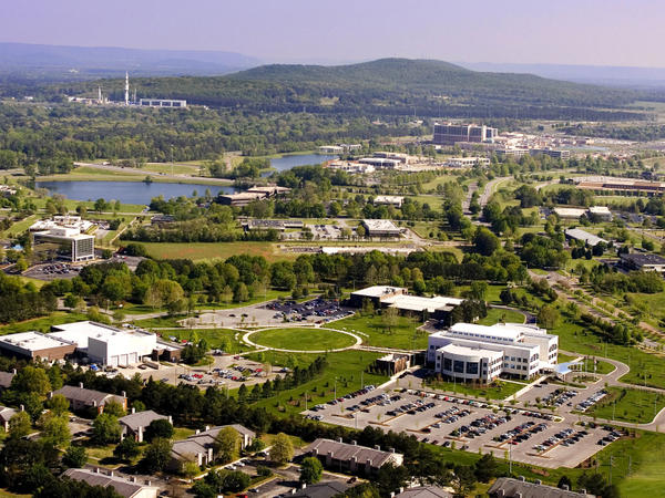 Huntsville's Cummings Research Park is home to 285 companies specializing in software design, engineering, aerospace and defense, computers and electronics and biotechnology. In the background is the Saturn V rocket model at the U.S. Space and Rocket Center.