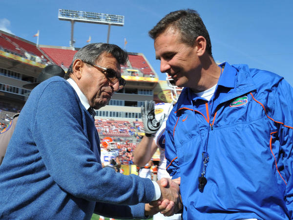 With Penn State coach Joe Paterno ousted, rumors are speculating that former Florida coach Urban Meyer will be his replacement. In January, the two shook hands before the Outback Bowl.