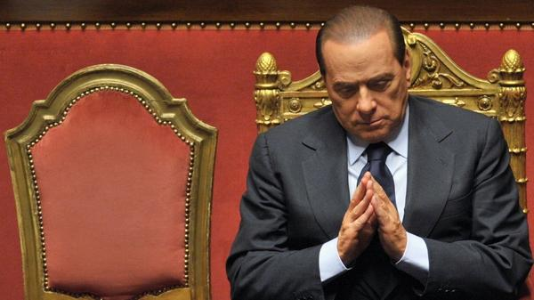 Prime Minister Silvio Berlusconi delivers an address to Italy's Senate in December 2010. Berlusconi, whose political survival skills are legendary, promised to step down after the Senate approved an austerity package.