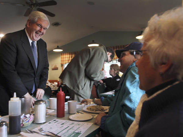 Gingrich talks to a breakfast crowd during a campaign stop at the Circle Restaurant in Epsom, N.H., on Friday. A new CBS poll of Republican primary voters finds him tied for second place with Mitt Romney, behind Herman Cain.