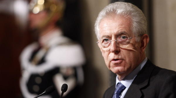 """Italy's new premier-designate economist Mario Monti meets with journalists at the Quirinale Presidential Palace after talks with Italian President Giorgio Napolitano in Rome on Sunday. Monti told reporters that he will carry out the task """"with a great sense of responsibility and service toward this nation."""""""
