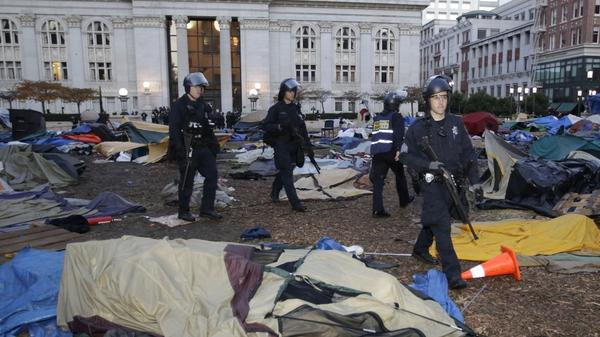 Police break up an encampment for an Occupy Wall Street demonstration in Oakland, Calif. Police began clearing out the weeks-old encampment early Monday after issuing several warnings to demonstrators.