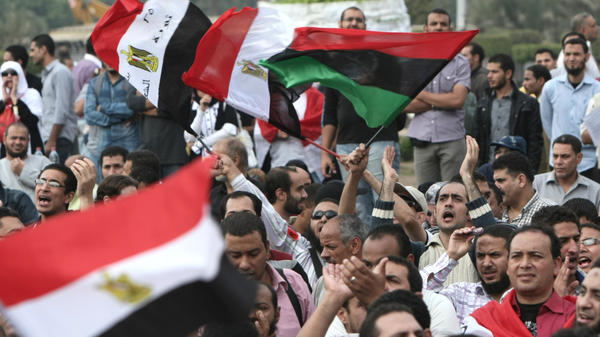 Egyptians attend a rally calling for a rapid transition from military to civilian rule following the February ouster of president Hosni Mubarak in Cairo's Tahrir Square.