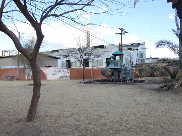 The Asarco copper smelter in Arizona looms behind a playground at the Hayden City Park.