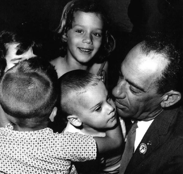 At Miami's airport, children from Cuba meet George Guarch, who worked for the Catholic Welfare Bureau in the city. Guarch took displaced children to temporary camps in Miami.