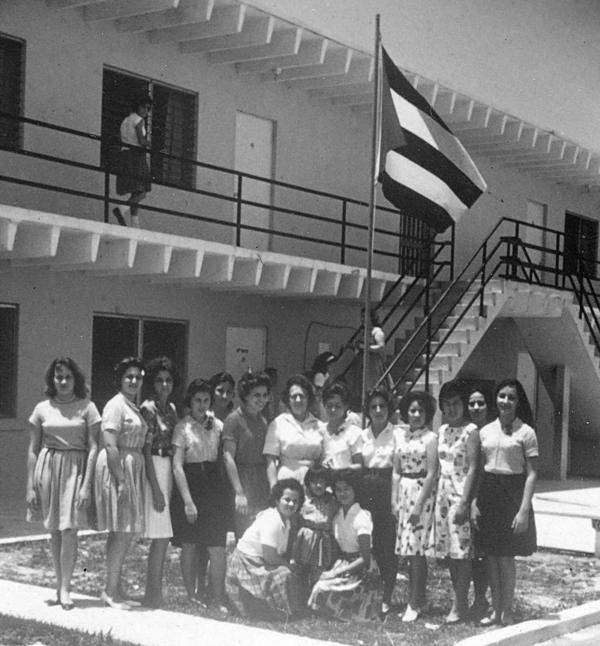 Carmen Valdivia (far right) and other girls lived at a camp for displaced children in Florida City. They had been airlifted from Cuba in Operation Pedro Pan.
