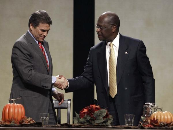 Republican presidential candidates Texas Gov. Rick Perry and former CEO of Godfather's Pizza Herman Cain talk after a forum sponsored by The Family Leader Saturday. Both men let their emotions show during the roundtable.