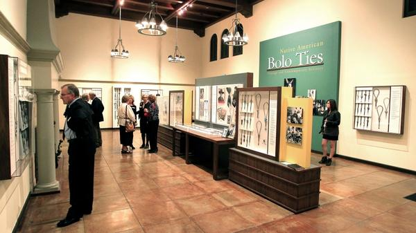 Patrons examine the bolo ties exhibit at the Heard Museum in Phoenix.