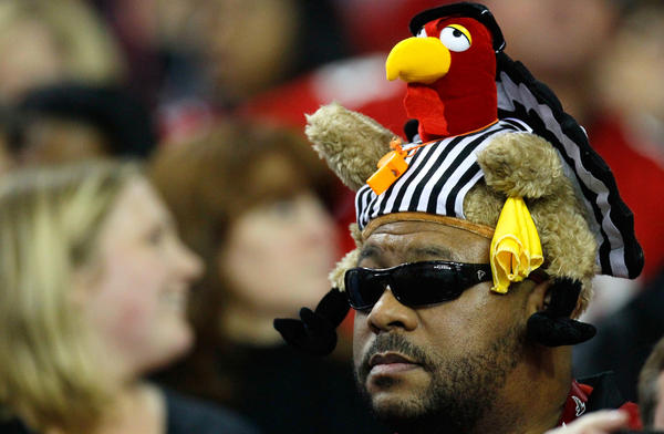With five of Thursday's six teams owning winning records, the NFL's 2011 Thanksgiving Day games are creating some anticipation. In Atlanta, a fan got into the holiday spirit last week, wearing a turkey/referee hat.