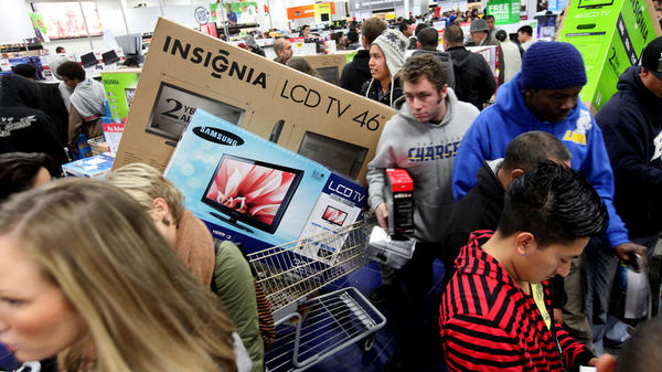 Customers shop for electronics items during Black Friday at a Best Buy in San Diego.