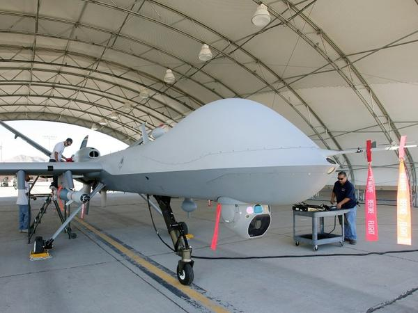 Mechanics prepare an MQ-9 Reaper for a training flight, Aug. 8, 2007, at Creech Air Force Base in Indian Springs, Nev.