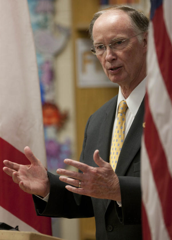 Alabama Gov. Robert Bentley is among several GOP governors accepting grant money to set up health insurance exchanges while also challenging the health overhaul law in court.