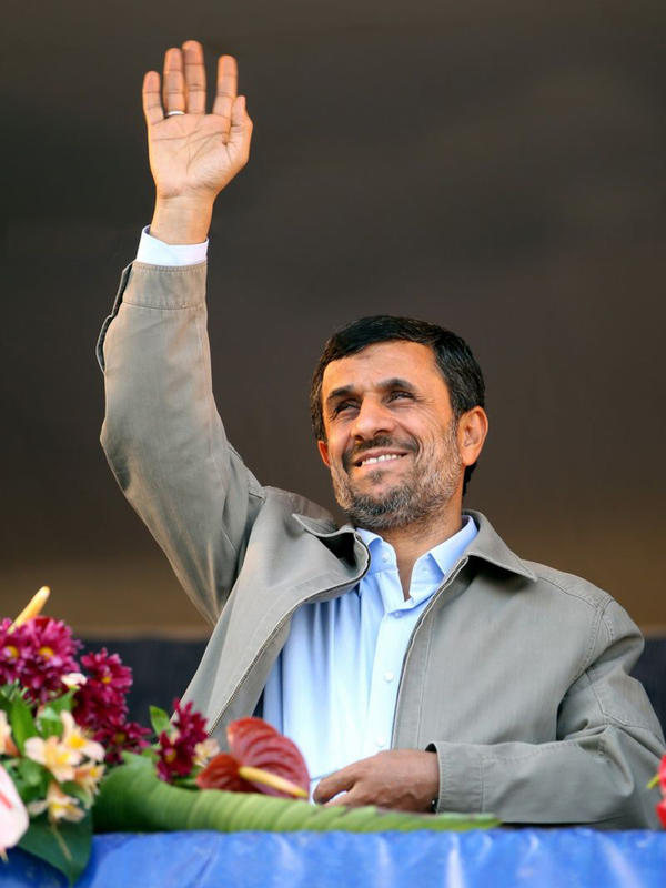 Iranian President Mahmoud Ahmadinejad waves in Pakdasht, southeast of Tehran, Nov. 23. Ahmadinejad on Wednesday said he was surprised at European moves to isolate Tehran's central bank.