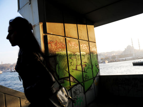 A woman walks up the stairs of Galata Bridge in Istanbul. With the financial crisis in the eurozone, Turks are rethinking their years-long bid to be a part of the European Union.