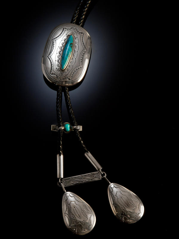 This silver and turquoise Navajo bolo tie was created in the early 1980s.