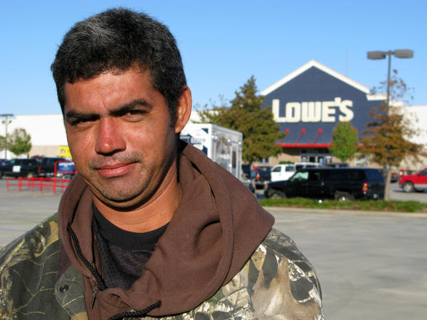 Day laborer Yohanni Castillo from Honduras waits for work outside a Lowes home improvement store in New Orleans. Jobs are drying up, he says, and he hasn't worked in four days. Even when work does comes along, he says, he doesn't always get paid.