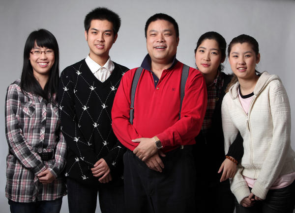 Wolf Dad Xiao Baiyou is shown in this publicity image with his four children, three of whom go to Peking University. He believes this is due to his method of beating his kids. The youngest is 16 and is hoping to study music at China's Central Conservatory of Music.